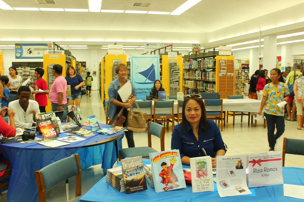 Dec 29, 2017: Author, Riza Ramos, with her independently-published  books at the Joeten-Kiyu Public Library 26th Anniversary  Author Meet & Greet event